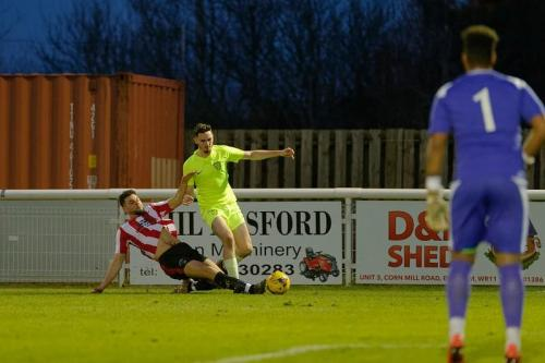 Photo 14 Bradley Wilson gets tackled on the touchline