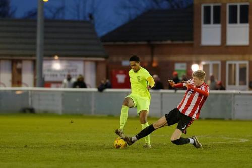 Photo 15 Jordan Edwards loses out to a tackle by the Evesham player