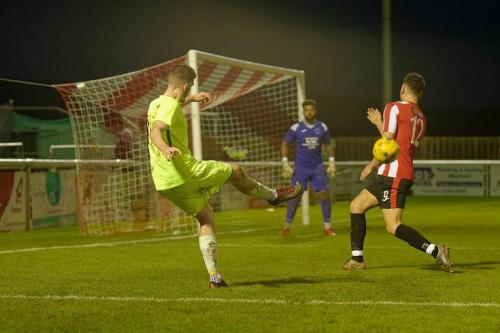 Photo 4 Bradley Wilson cross gets blocked - handball